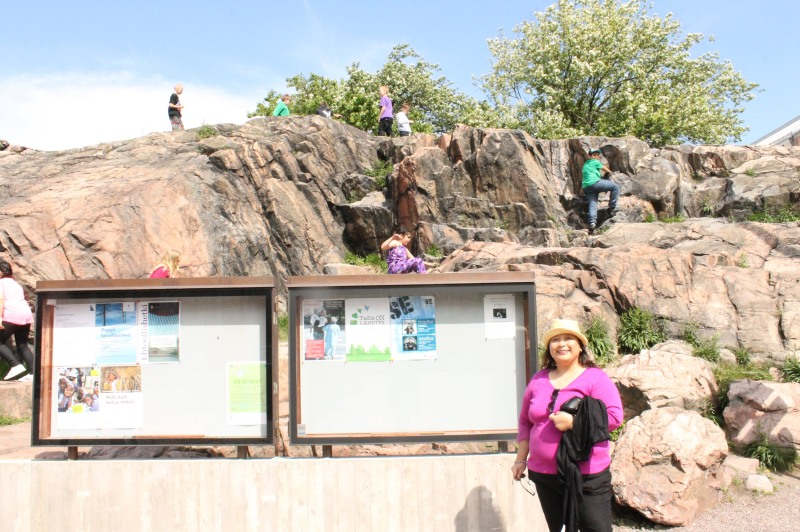 Outside the Temppeliaukio Church.  Notice the people climbing the rock roof.