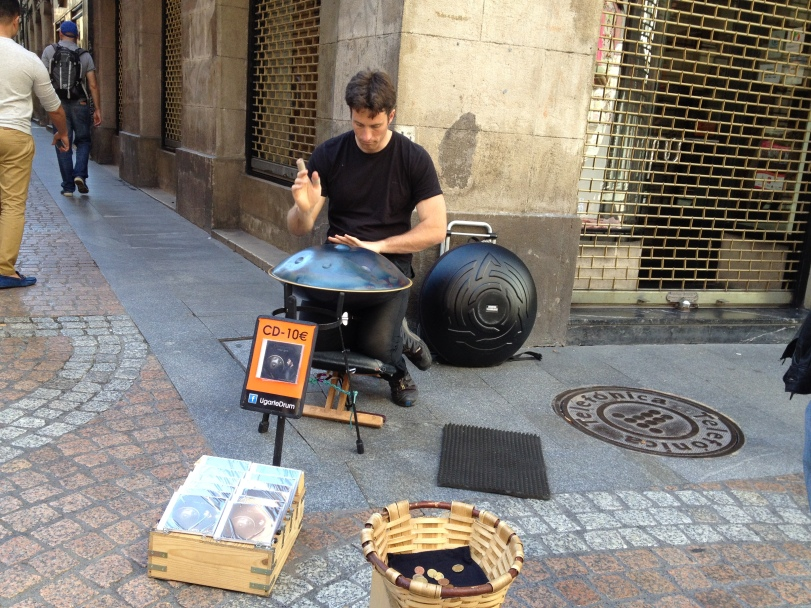 "The typical ""music' man along roads in the old town"